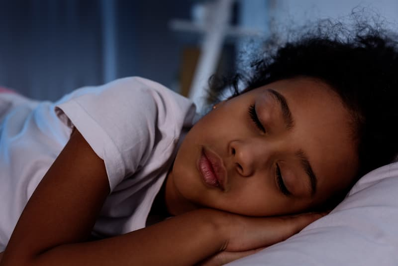 african american girl lying on pillow sleeping vision academy riverside indianapolis